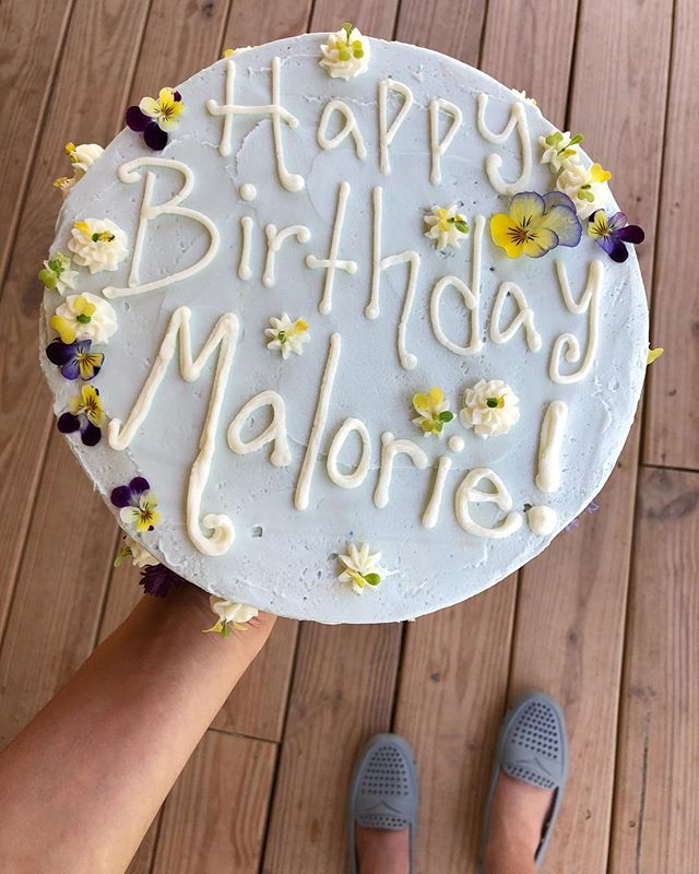 We do birthdays too! This little cutie is our classic vanilla cake with buttercream icing. We used fresh edible flowers from our friends @bluelanternflowers. Never have I ever tasted a flower like these! Sooo delicious! -and pretty too! . Side note, pictured here are my super comfy @floafers! Absolutely love them!!! Waterproof, slip proof and so light weight! The perfect shoe for work or the outdoors!