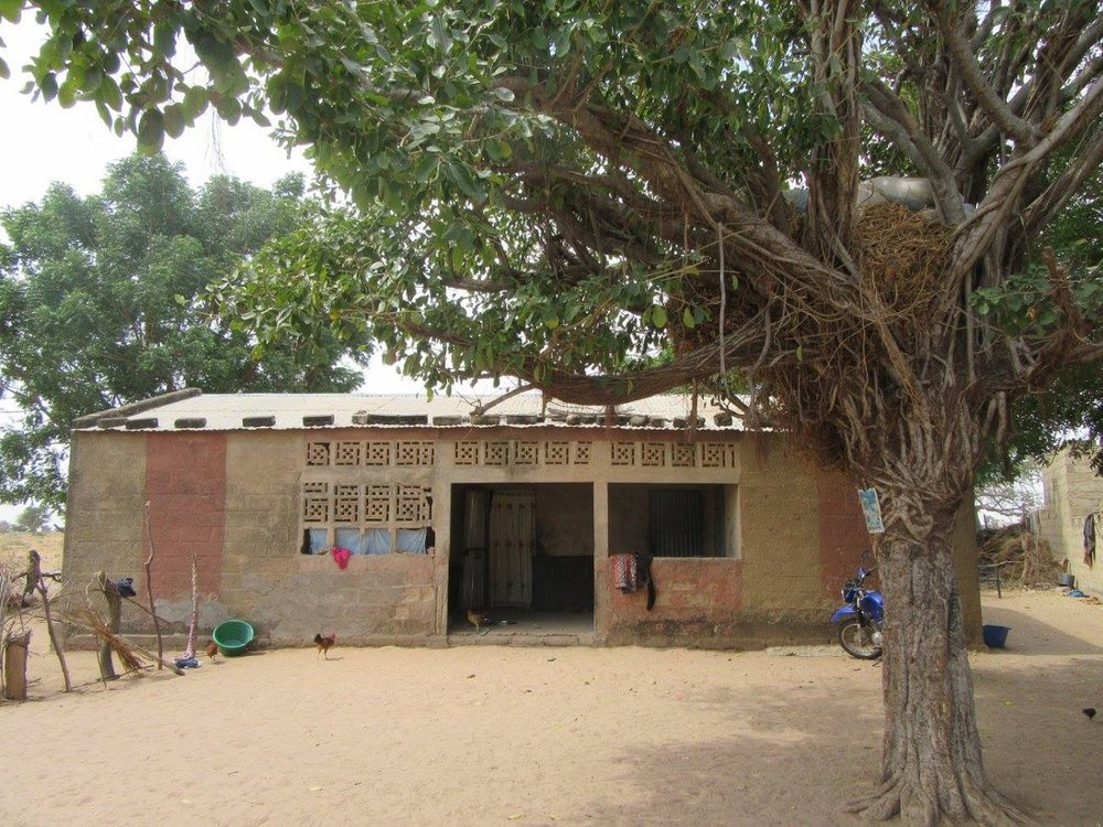 We met next to this house, my host family's house in Befel, Senegal.