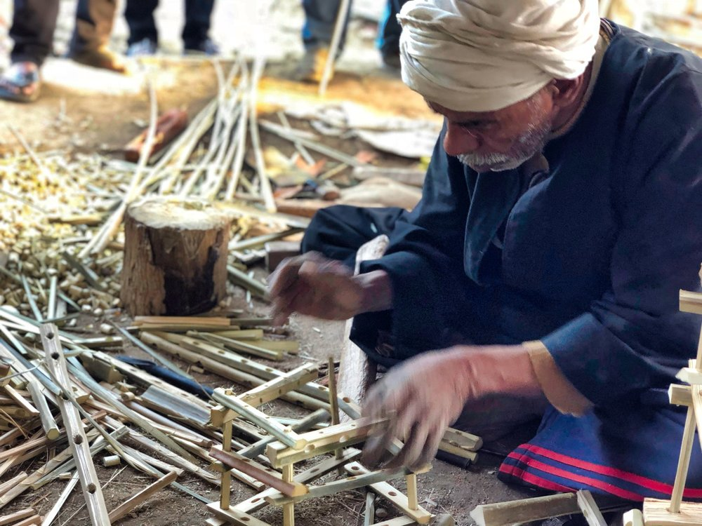 A Village Craftsman Making A special Box for us Out of date palms. Typically he creates larger boxes to transport crops such as tomatoes.