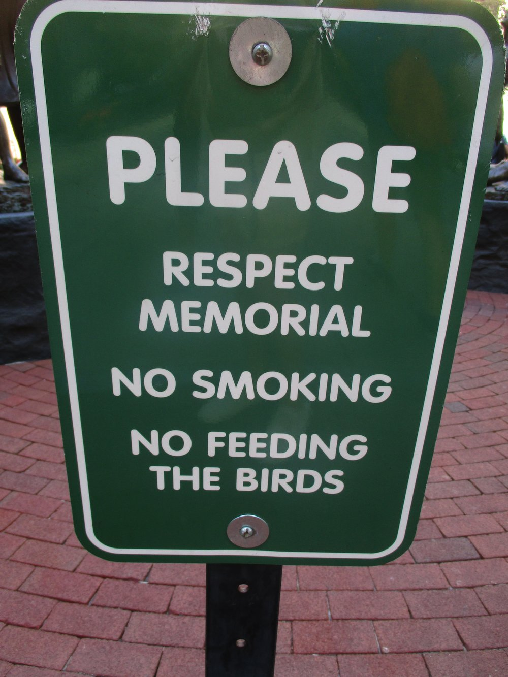 Etiquetteer wishes it wasn't necessary for signs such as these to be posted. Everyone should know how to behave at a memorial, and want to behave that way.