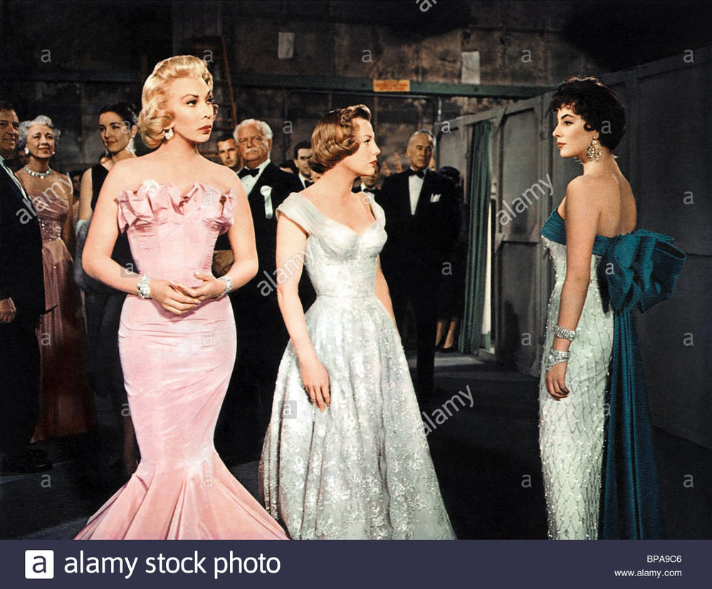 "Dolores Gray, June Allyson, and Joan Collins. That's Bess Flowers, ""Queen of the Extras,"" in the back at left."