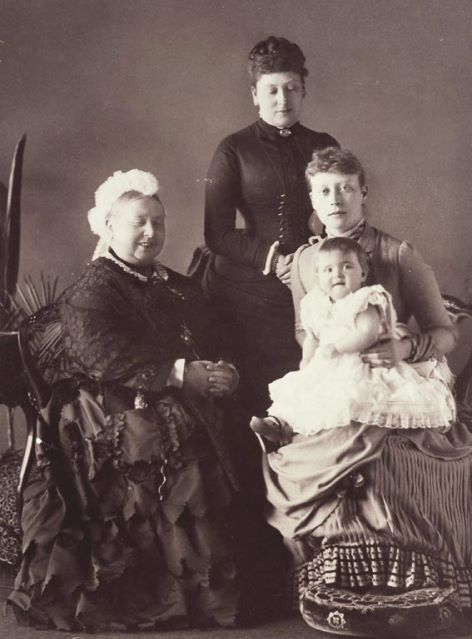 Queen Victoria sporting a smile at a great-grandchild. Too bad she couldn't keep her eyes open at the same time.