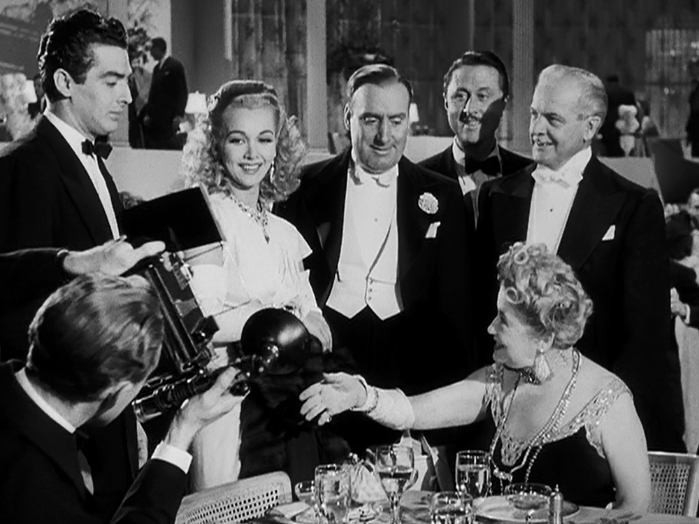 Lady Handel hosts a private dinner party in a very public restaurant in  I Wake Up Screaming  (1941).