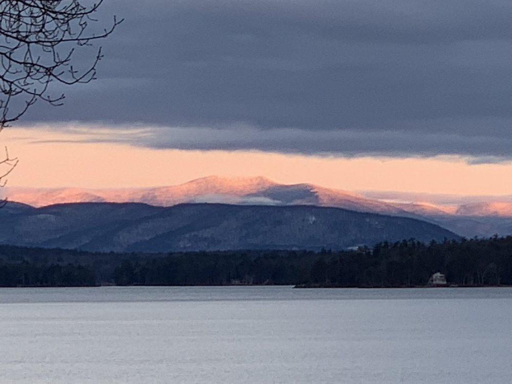 The dawn tinges the mountains of New Hampshire.