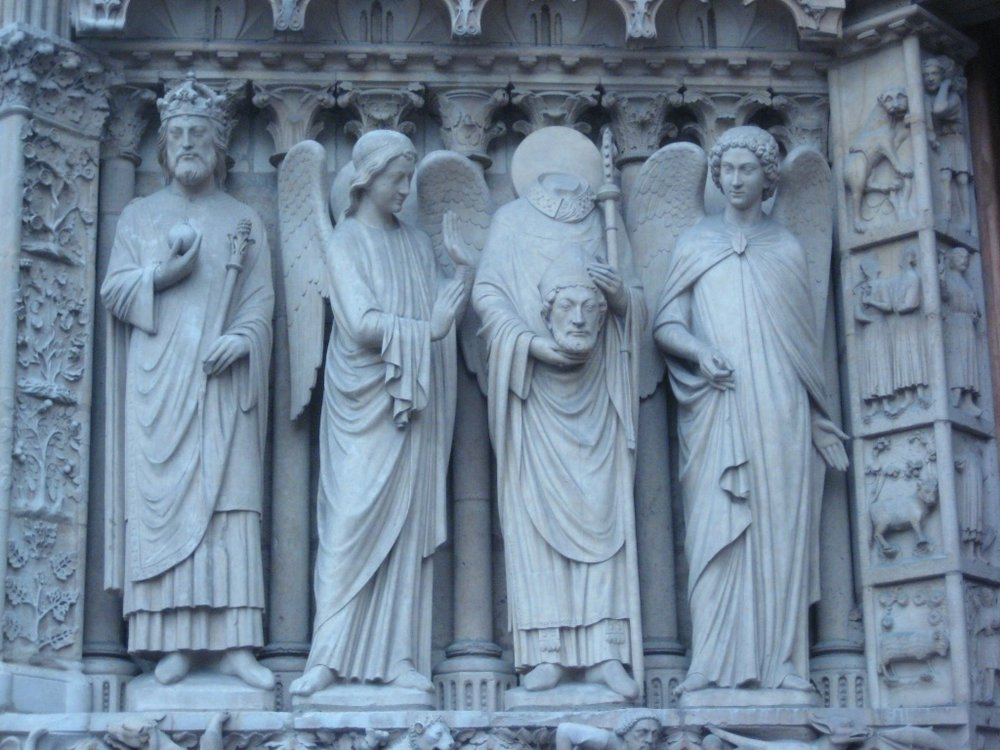 The entrance of Notre Dame, including St. Denis carrying his own head. October, 2008