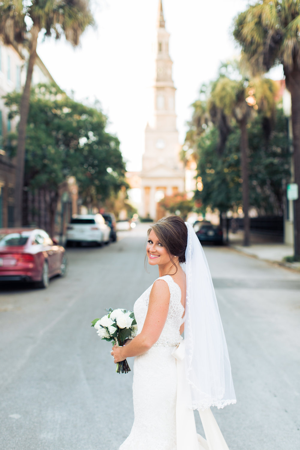 Our first stop at Brittany and Shawn's engagement session also became our first stop at her bridal session! There is just something so iconic about St. Philip's Church and where it sits on quaint Church Street in downtown Charleston where Cobblestone streets meet with pink houses.