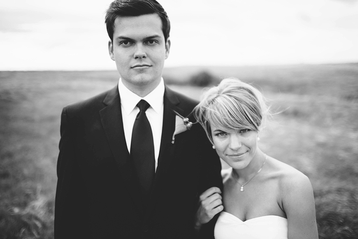 Lethbridge Wedding Photographer, Calgary Wedding Photographer, bride and groom in a field, black and white