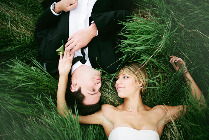 Lethbridge Wedding Photographer, Calgary Wedding Photographer, bride and groom laying in the grass, long grass