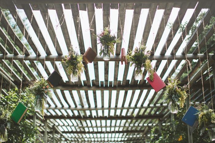 wedding ceremony, hanging books, hanging mason jars, rustic, vintage, handmade style