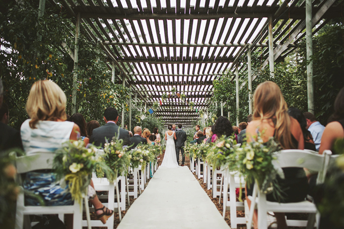 rustic wedding ceremony, hanging mason jars, hanging books, saskatoon farm wedding, calgary wedding photographer, david guenther