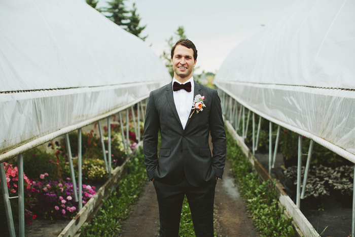 groom with bow tie, dark grey suit, hugo boss, saskatoon farm wedding, calgary wedding, david guenther
