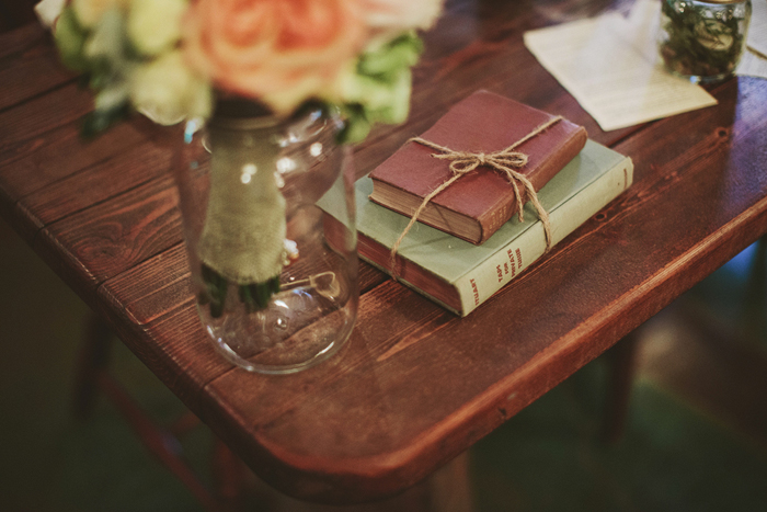 rustic wedding, vintage books center pieces, flowers in mason jar, saskatoon farm wedding, david guenther