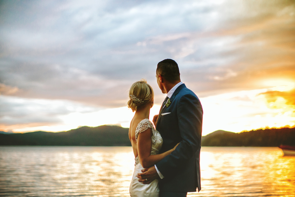 bride and groom at sunset, sunset portrait, sunset on lake, stormy clouds