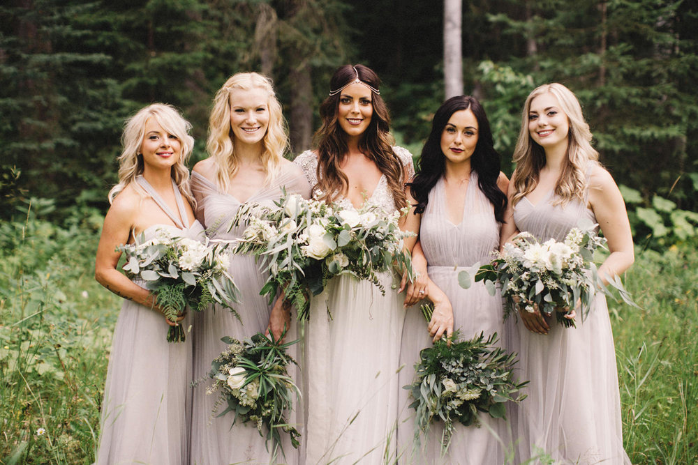 bride and bridesmaids, boho chic bride, boho bridesmaids, bride with hair down, golden wedding, hillside chalets wedding