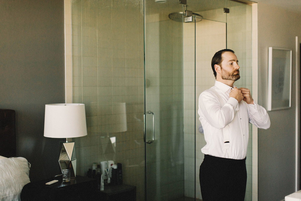 calgary wedding photographer, calgary wedding, fairmont palliser hotel, groom getting ready, armani wedding
