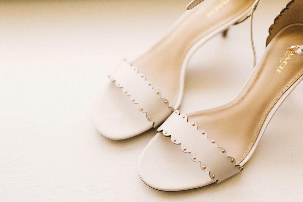 calgary wedding photographer, calgary wedding, fairmont palliser hotel, bride getting ready, coach shoes