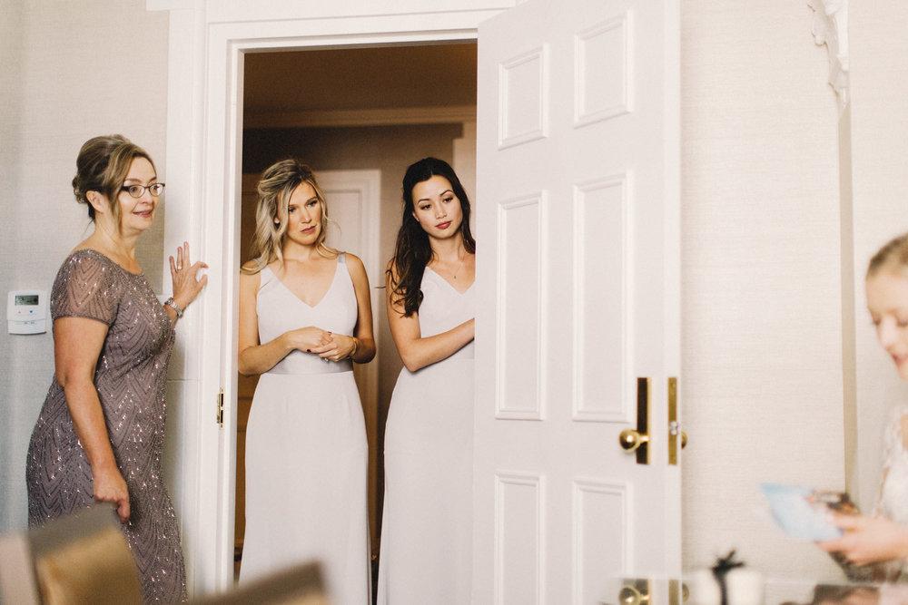 calgary wedding photographer, calgary wedding, fairmont palliser hotel, bride getting ready, reem acra dress