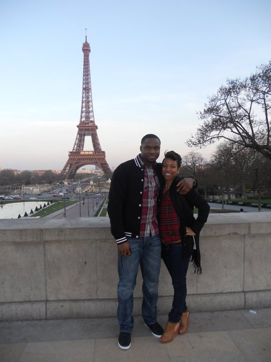 couple in front of eifel tower