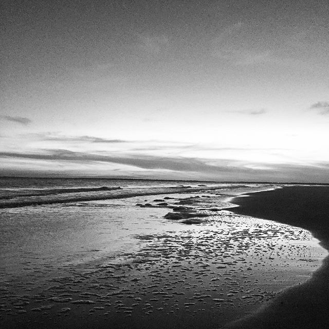 Another sketch of a photograph waiting to be developed...assuming I remember correctly and it will be black and white. Taken walking along the beach at sunset. Foam speckles the shore moving along with the tide.  #charleston #sunset #beachfind #beachplease #foamthatroams #bw #photography #sketch #horizon #geoempathy #alongtheway