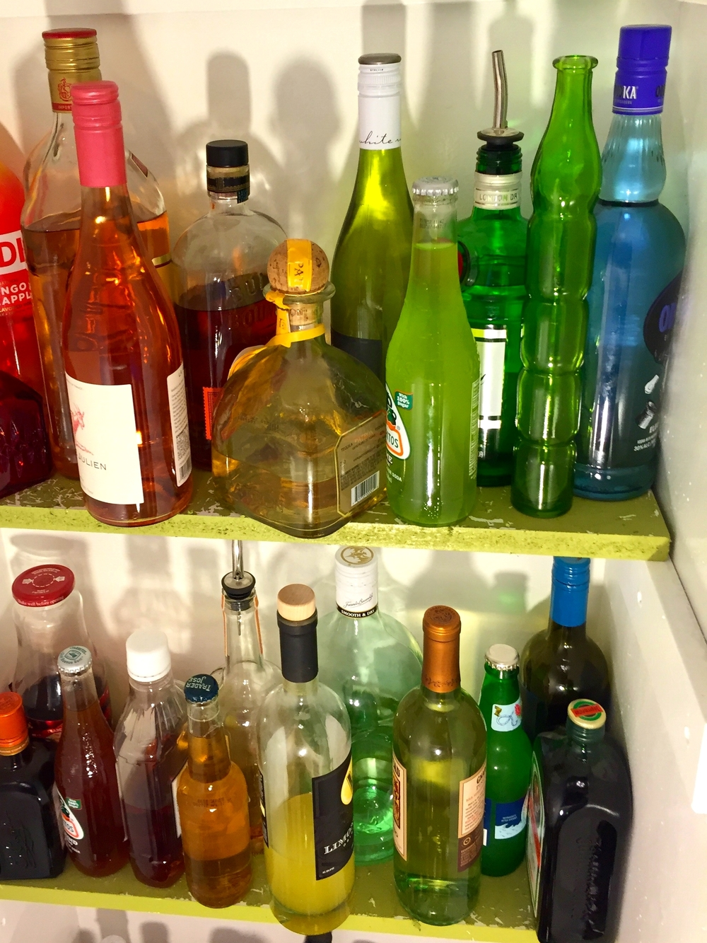 Rainbow organized liquor cabinet