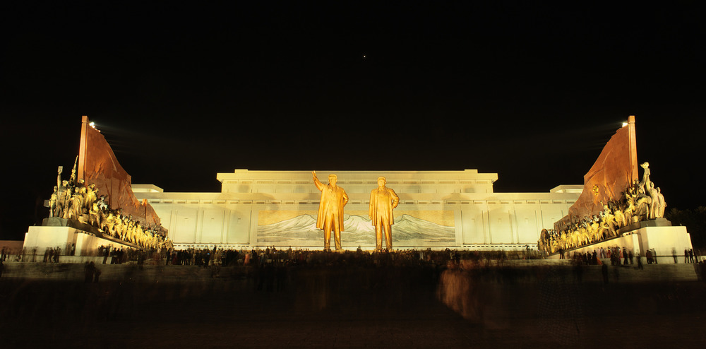 The day Kim Jong Il was unveiled next to his father Kim Il Sung. Kim Jung Ill past a few months prior. The space around the monument was pitch black and filled with thousands of people - no one spoke, the silence was deafening