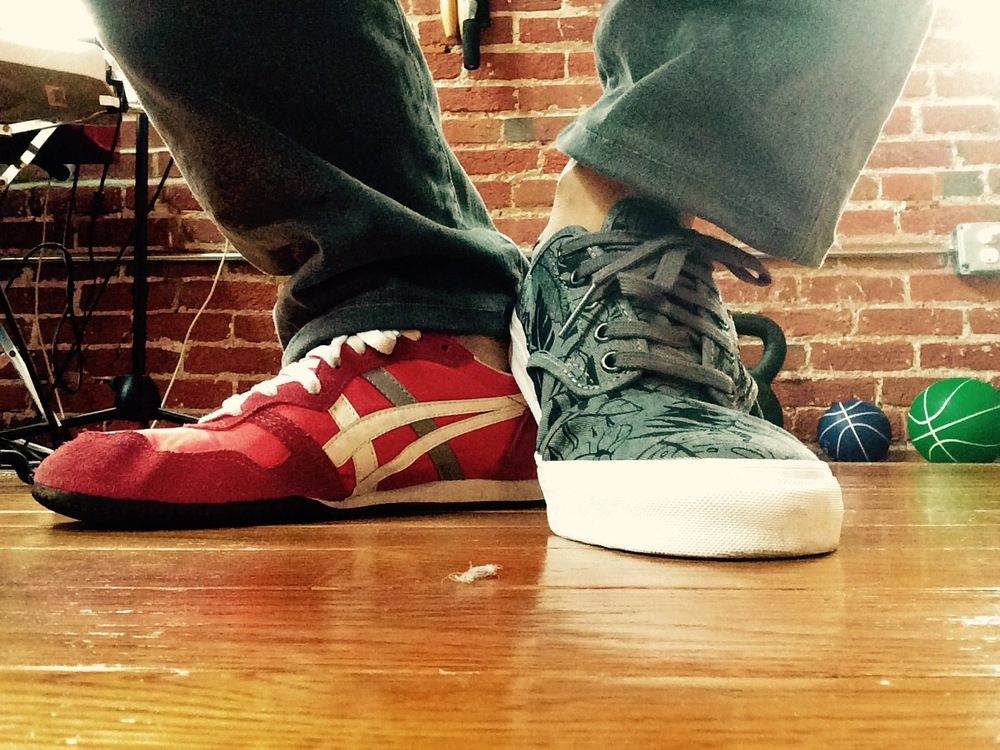 poetsandshoes: Patrick Rosal (Philadelphia Correction) is reading Silent Anatomies by Monica Ong. Right foot: Tiger Onitsuka (red w white and gray stripe); Left foot Chima Ferguson Pro Vans (Gray Leaf design).