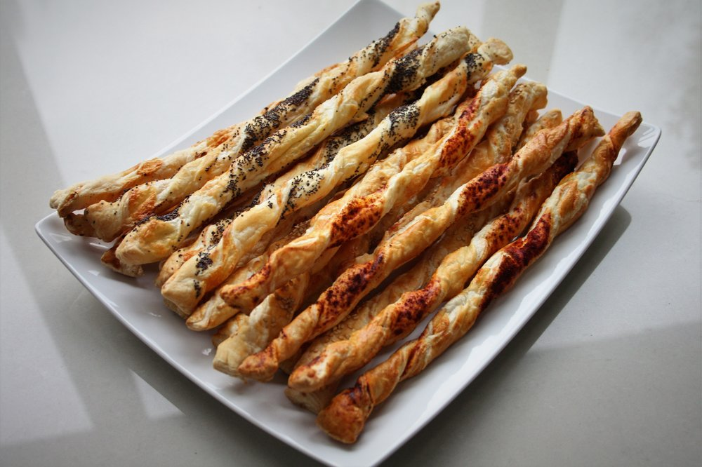 Easy Cheese Twists - Makes 20375g ready-rolled puff pastry100g Stephensons Free Range Creamy Lancashire cheese1 egg, beaten1 teaspoon each poppy seeds, sesame seeds, paprika, chili flakes, herbs - optionalMethod1.  Heat the oven to 190C fan/220C and line 2  large baking trays with non-stick greaseproof paper.2. Unroll the pastry and brush with the beaten egg3. Grate the Stephensons Lancashire cheese all over the pastry, and press it down.4. Fold the pastry in half, and then roll to the thickness of a £1 coin5. Cut into 2 cm strips and brush each strip with the beaten egg on both sides.6. Sprinkle one side with your chosen topping - and then twist each end in opposite directions about 3 turns. Place on the baking trays.7. Bake for 15 minutes and serve warm.  Can be kept for up to 3 days in an airtight box and reheated at 160Cfan/180C for 3-4 minutes before serving.