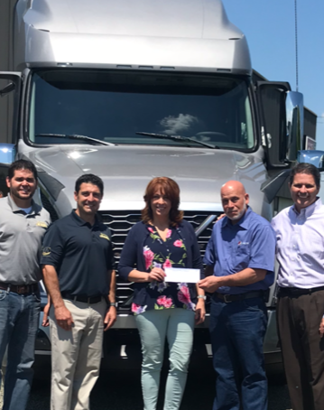 Central Region Touch-a-Truck - TANY Central Region Vice Chair Steve Erwin of Clinton's Ditch Co-Op, Inc. presents a check to A Room to Heal, beneficiaries of the Central Region Touch-a-Truck event held May 5 at TANY member Burr Truck & Trailer Sales, Inc.'s Vestal, NY facility.