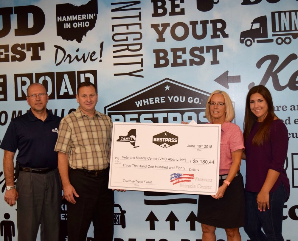 Eastern Region Touch-a-Truck - Melody Burns of Veterans Miracle Center receives a check for more than $3,100 from TANY and Bestpass, whose May 19 Touch-a-Truck event in Wilton, NY benefited the organization. TANY Eastern Region Vice Chair Joe Fitzpatrick of Lightning Express Delivery Service, George Damoretcki of TANY, and Nicole Oulette of Bestpass presented the check.