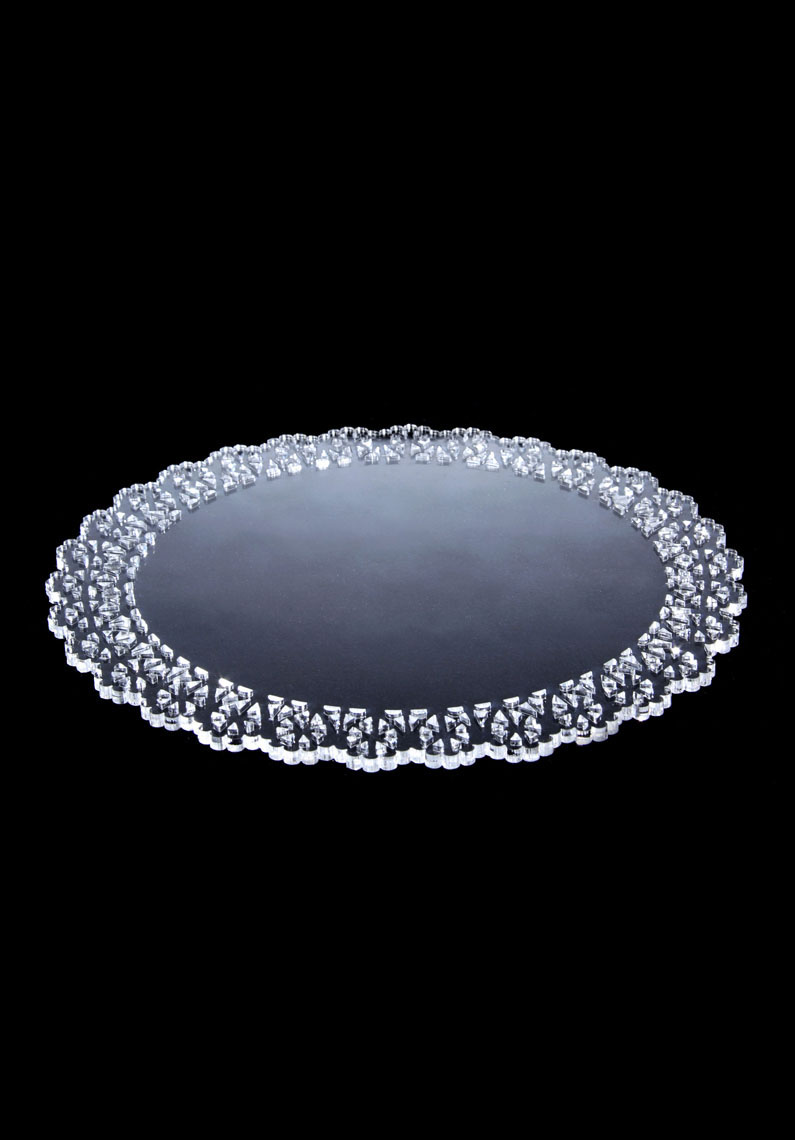 Doilies  Laura Coley & Jonathan Krawczuk Combining modern technology and materials, with the craft like qualities of the traditional doily, our product aims to reinvent this accessory for the contemporary home.