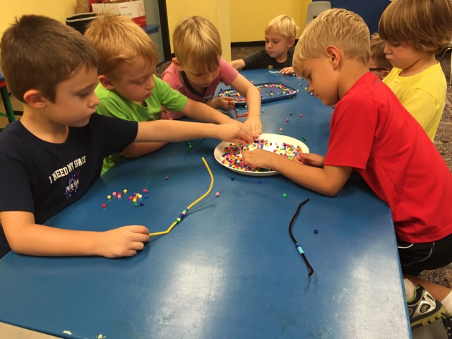 Campers explored color and patterns while picking out beads for a bracelet.