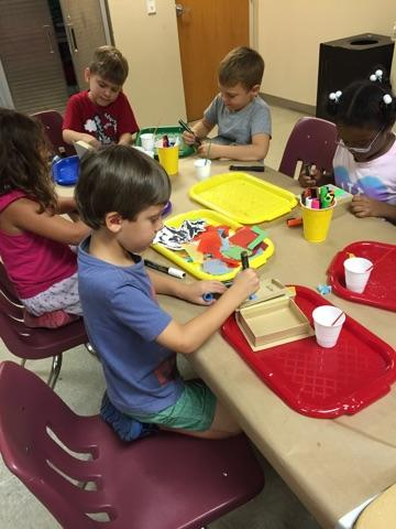 Campers used feathers, tissue paper, sequins and other materials to decoupage their storybook boxes.