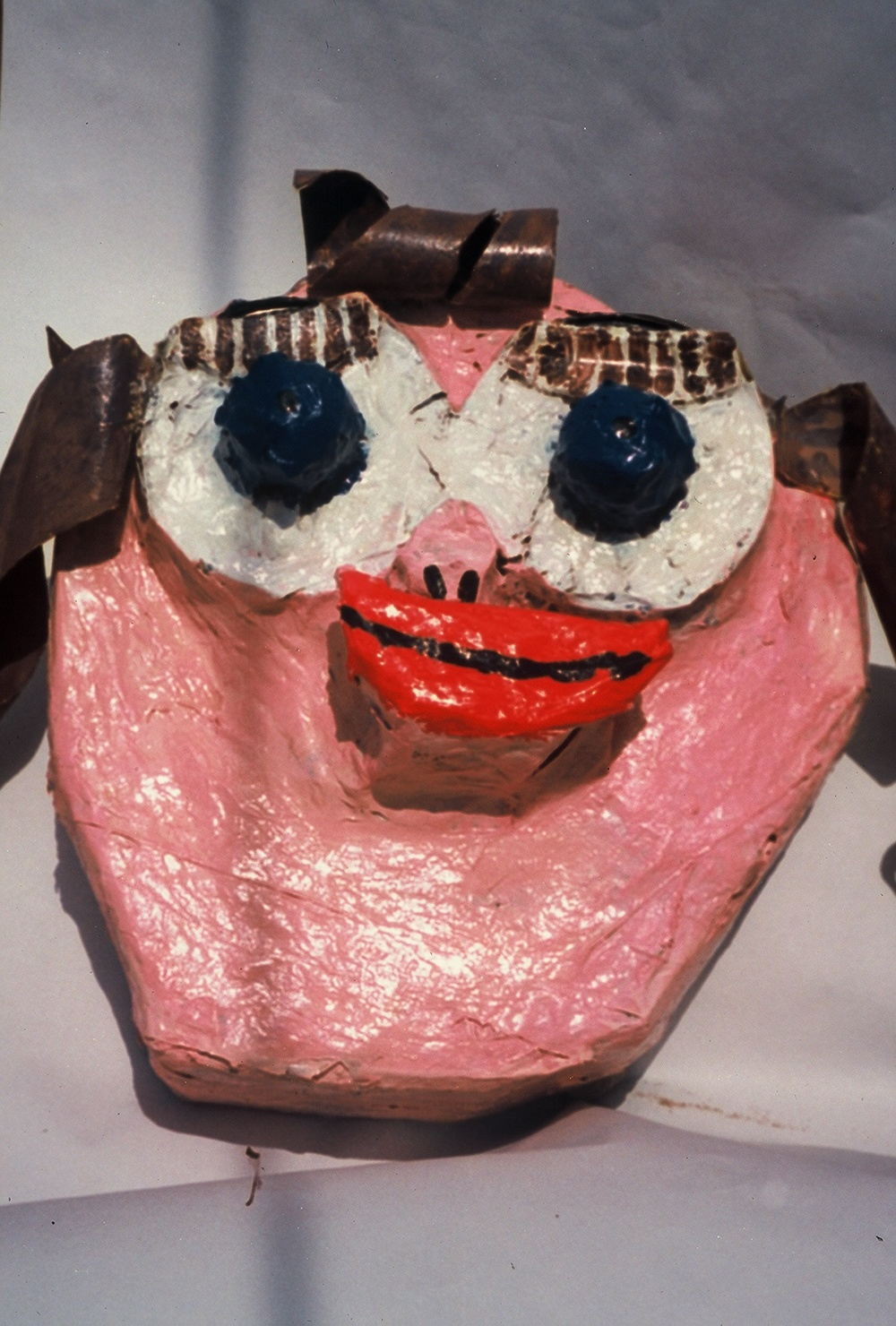 While living in New Mexico, I collaborated with Lind Piper, an actor, story teller and theater director, on several projects. This is a huge papier maché head, one of several made by students at an elementary school in Farmington, NM. The heads depicted the various stereotypes in the play that the children wrote and acted before an audience of friends and family. The message of the play was: learn to see people as individuals and not as stereotypes based on prejudice.