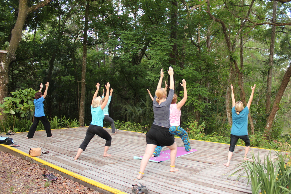 Some of the participants during the Spring Mixed Media Creativity Retreat at Rainbow Rivers Center in 2016 at an early morning yoga session prior to returning to their cabins to make art.