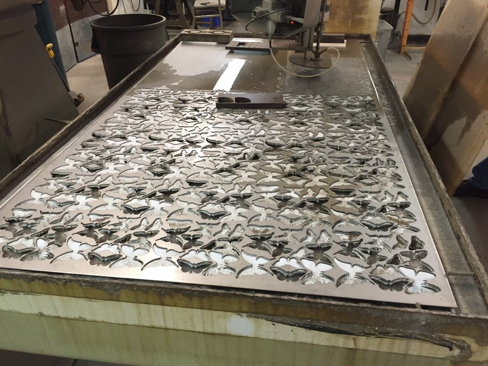 While we were fabricating the mold we have also been preparing a computer program to water jet cut the butterflies from a sheet of stainless steel.