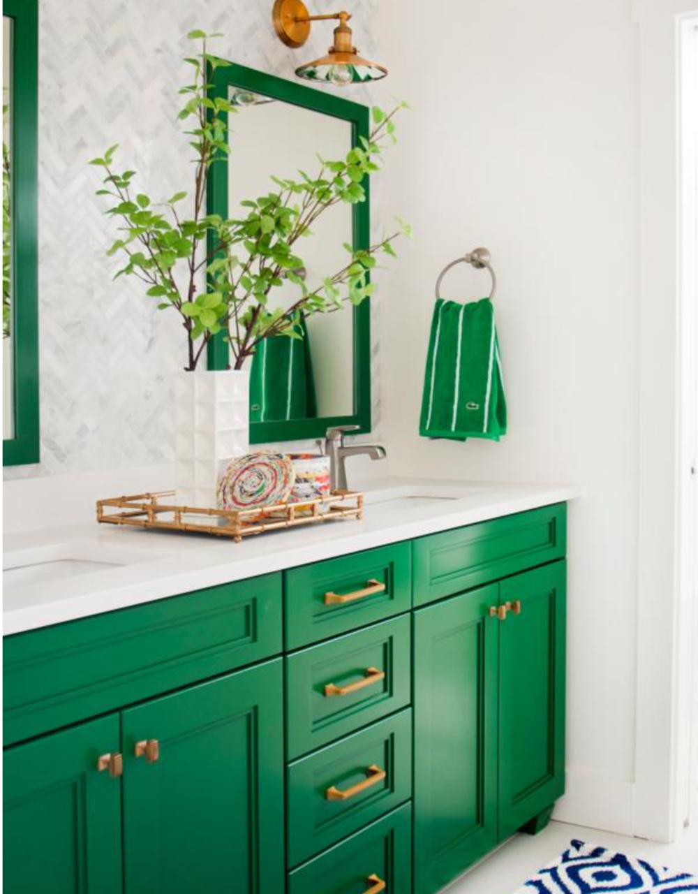 Having a green moment lately- and this (spotted on HGTV's website), in a high gloss finish, could be so cool. Yes, kind of random as we have no green anywhere else in our house, but still, a girl can dream...