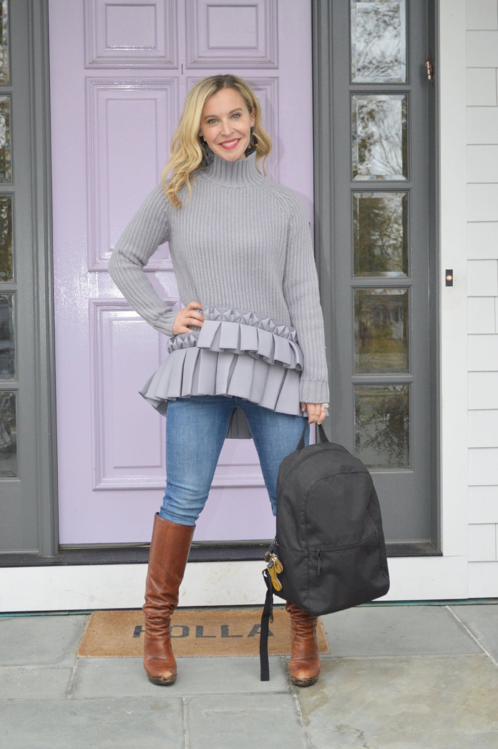 SHOP THE LOOK:  Sweater  /  High Rise Skinny Jeans  /  Boots  (similar to pictured) /  Backpack