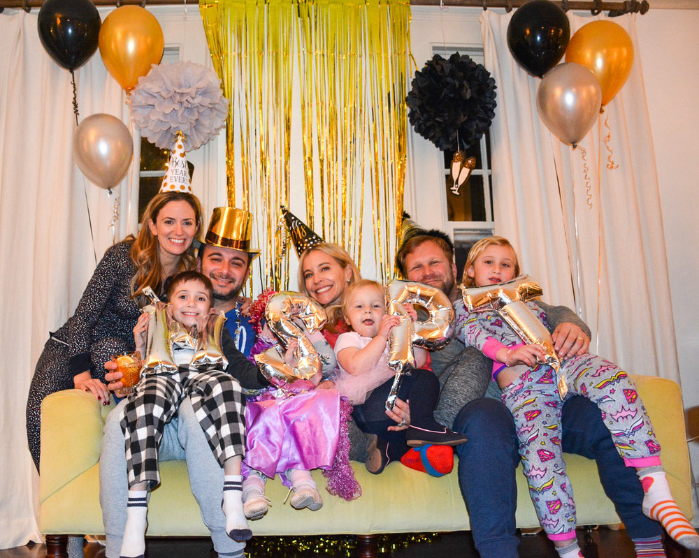 "A snapshot of how we rang in 2018 (well, almost- my crew was in bed by 10:30pm!)- spending time with close friends, wearing pjs, donning silly hats and letting our kids do as many ballet shows and magic shows for us as they damn well pleased, fueled by a generous ""as many toppings as you want tonight"" policy at the make-your-own-sundae dessert bar."