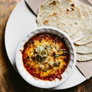 At his Minero restaurants, Sean Brock serves house-made tortillas with queso fundido.