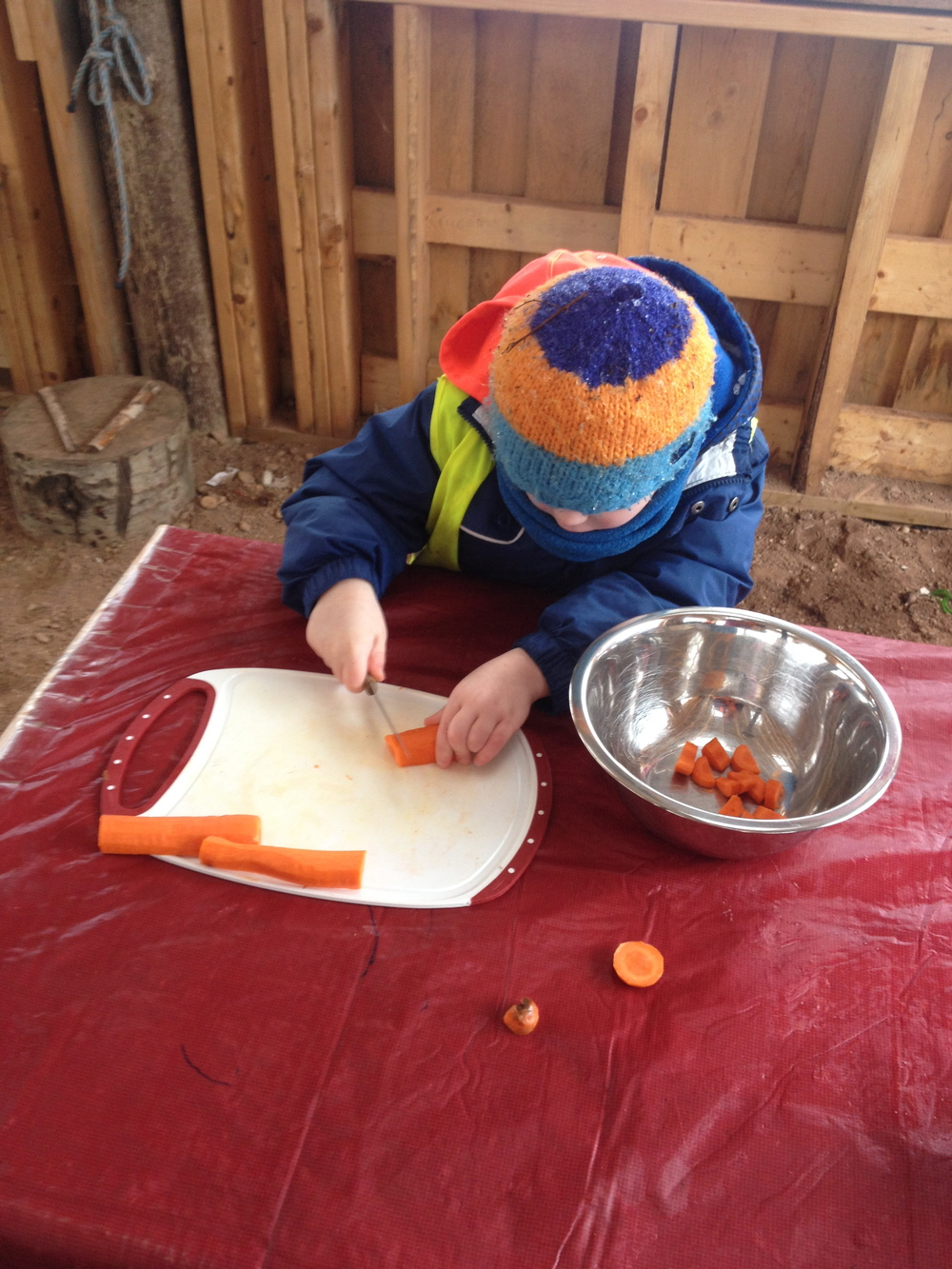 Matthew concentrates on cutting his carrot. Well done, Matthew!