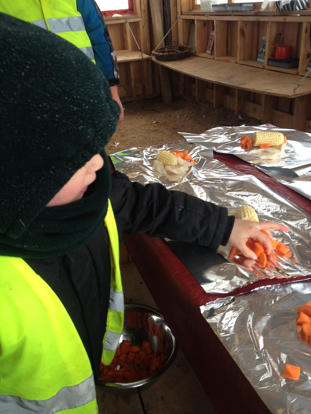 Sawyer did a great job placing the cut up carrots on each serving for the fire. Sawyer indirectly practiced his math skills by taking extra effort to make sure each meal had roughly the same amount of carrots.
