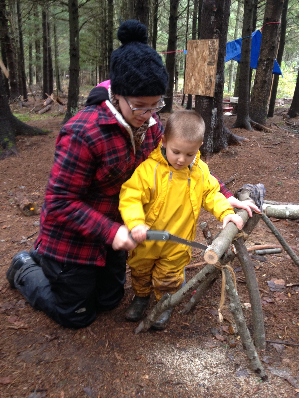Our forest school educators work one-on-one with a child when they are using sharp tools.