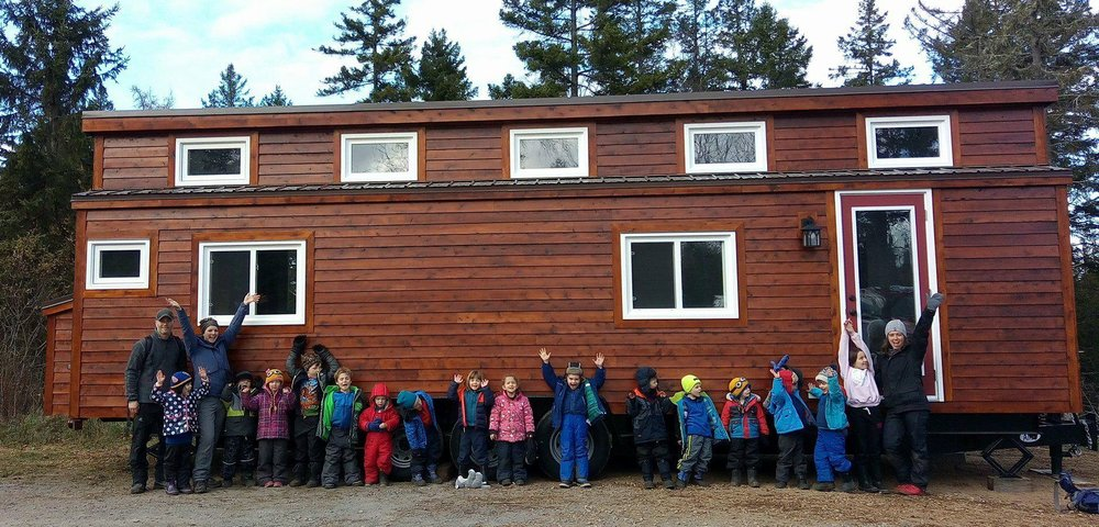 Celebrating the delivery of our brand-new tiny schoolhouse on wheels!