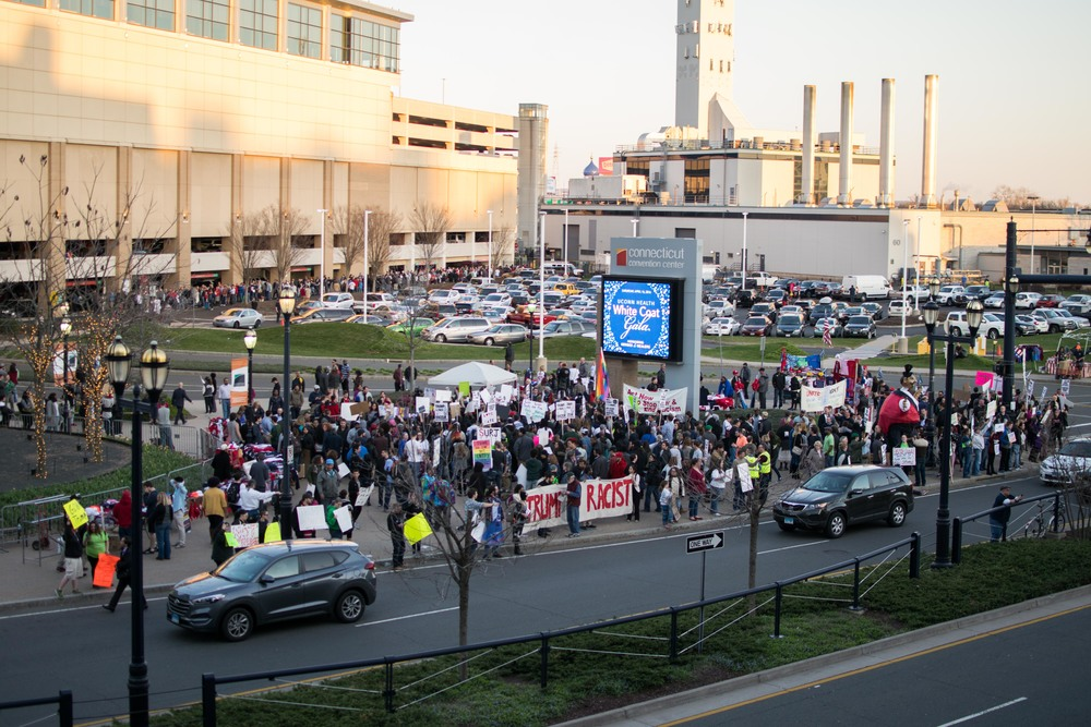 The original crowd of protesters gathered outside of the Connecticut Convention Center, at about 6:45 P.M., some of whom had already been there for nearly four hours.