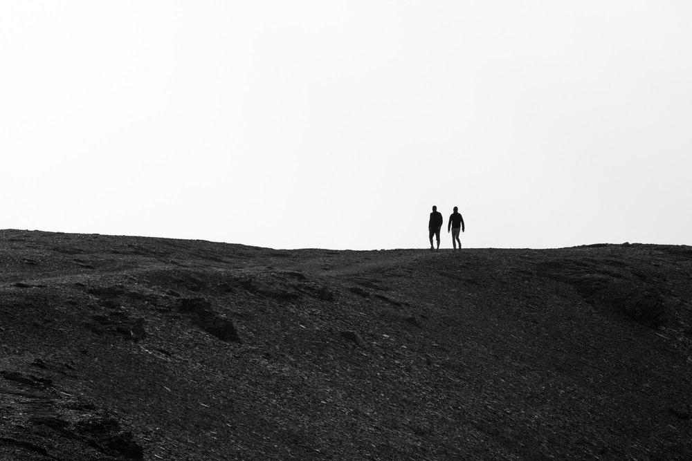 Two hikers on the Summit of Whistlers Peak in Jasper National Park in Japser, Alberta.