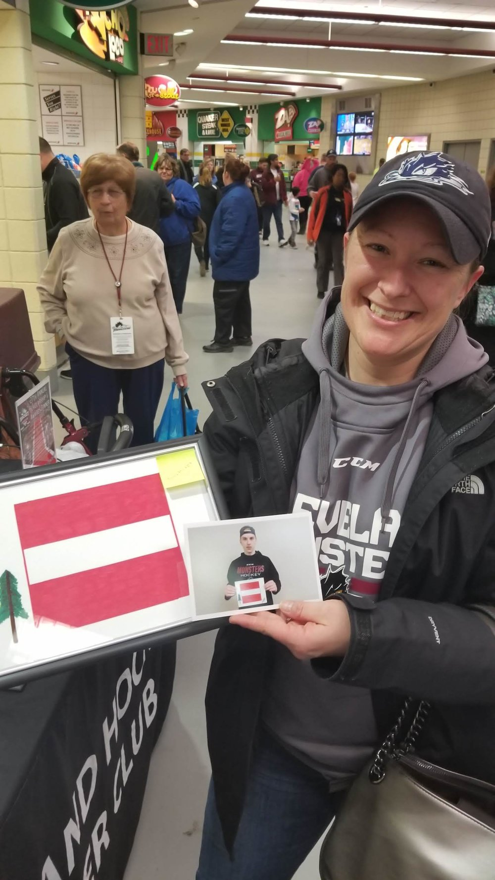 Katie Nichols was SUPER excited to get Matiss Kivlenieks drawing. I told her about him drawing and how he was trying to make sure everything was so straight with that flag. Congratulations Katie! - We will certainly miss him (until hopefully he comes back)