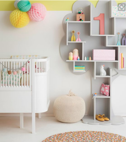 Nursery with paper pom poms and pom pom garland. Image: Pinterest