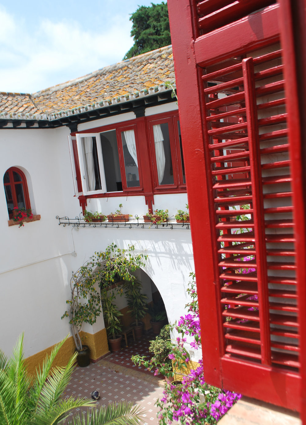 Classic Spanish shutters in red.