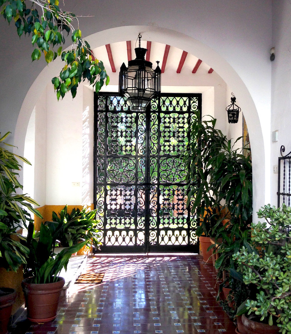 The entrance hallway with traditional tiling and lanterns.