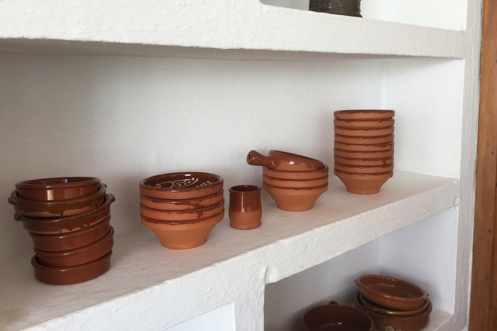 Tapas bowls grouped together create a simple display.